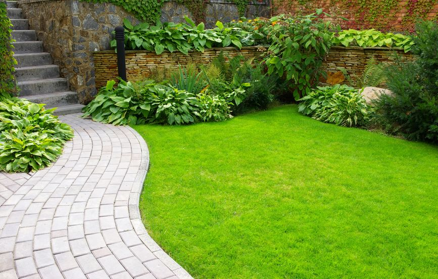 A Picture of a Garden Stone Path with Grass.