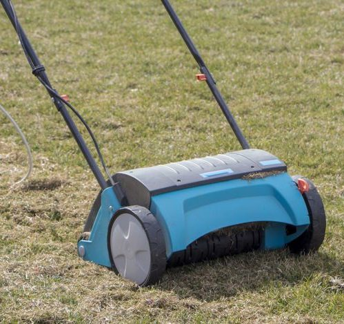 A Picture of a Soil Aeration Machine On Grass.